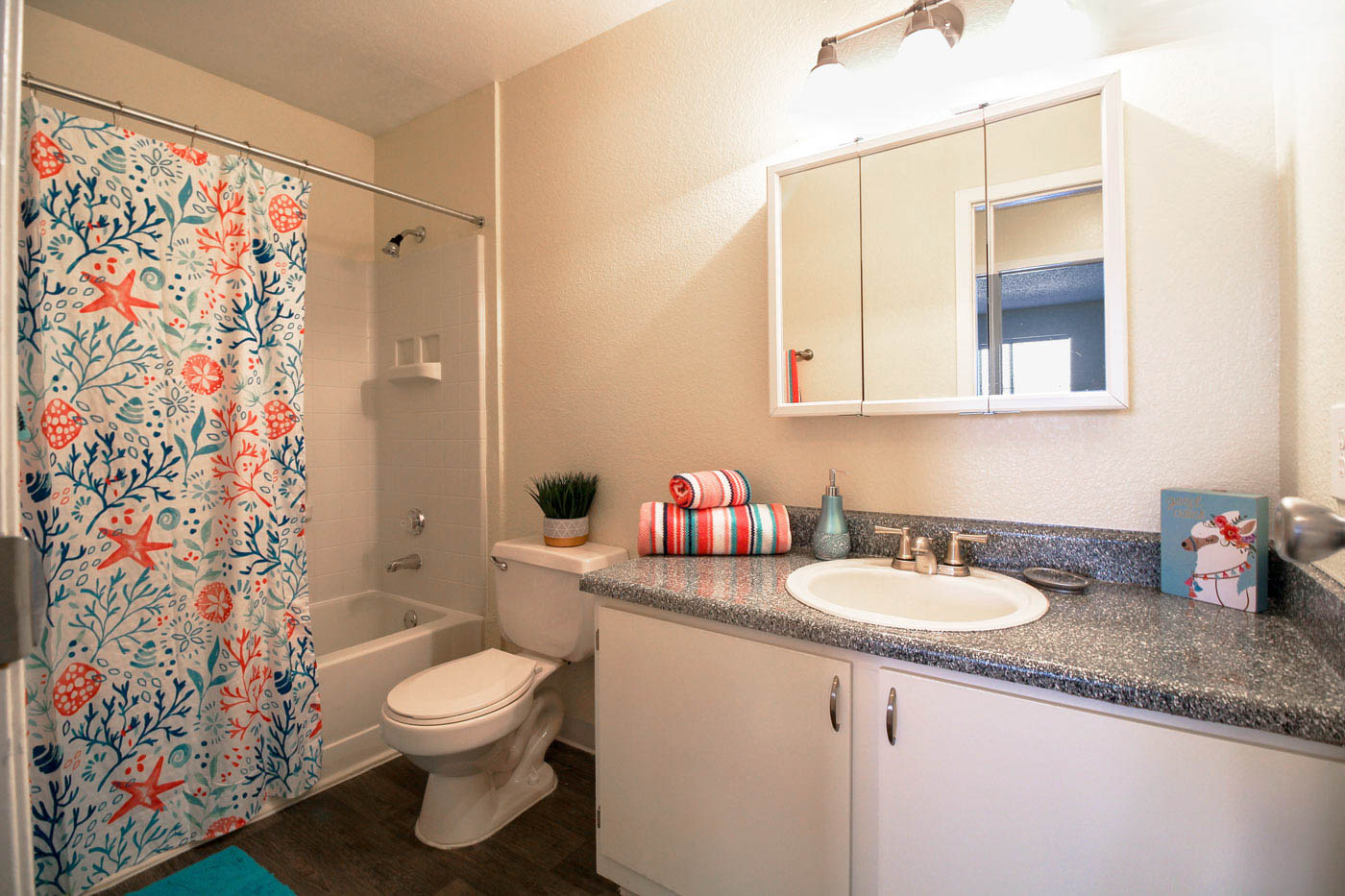 Full bathroom with colorful orange and blue decor.