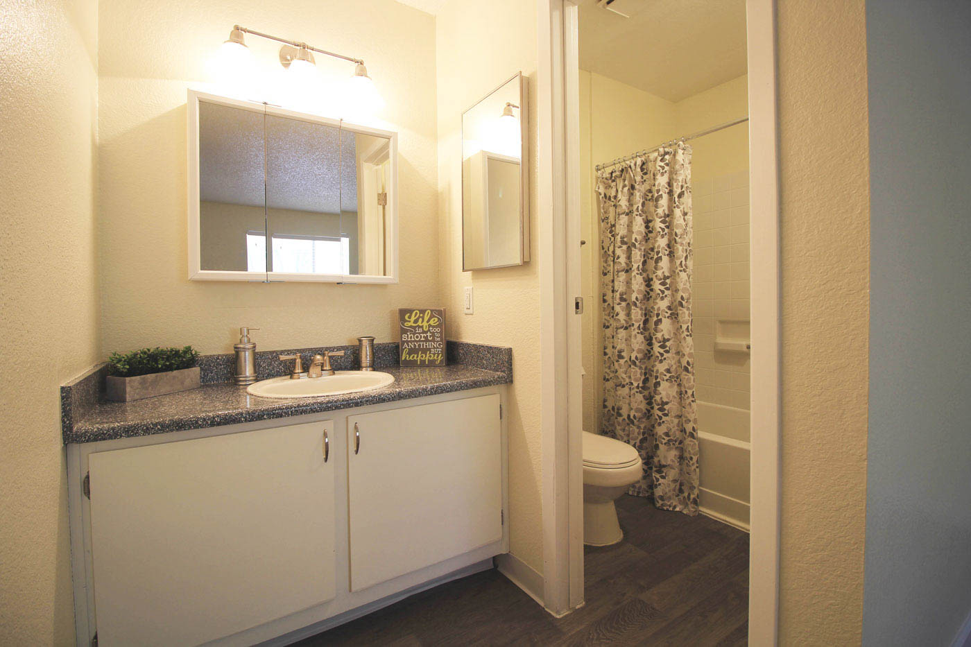 Full bathroom with shower and sink.